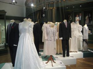 The centrepiece of the exhibition, gowns and suits of different eras.