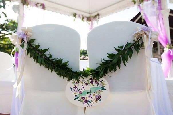 Fern garland on couple's chair decoration