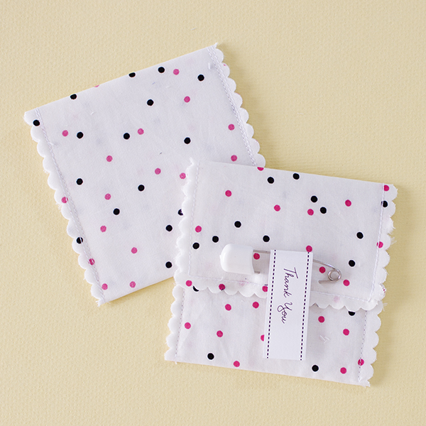 Erin - Pink and black speckled dots fabric favour pouch