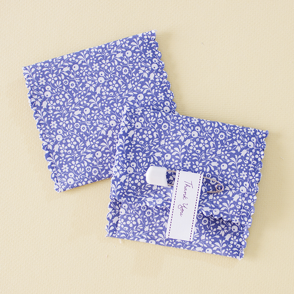 Papuru - White flowers on a bright blue fabric favour pouch