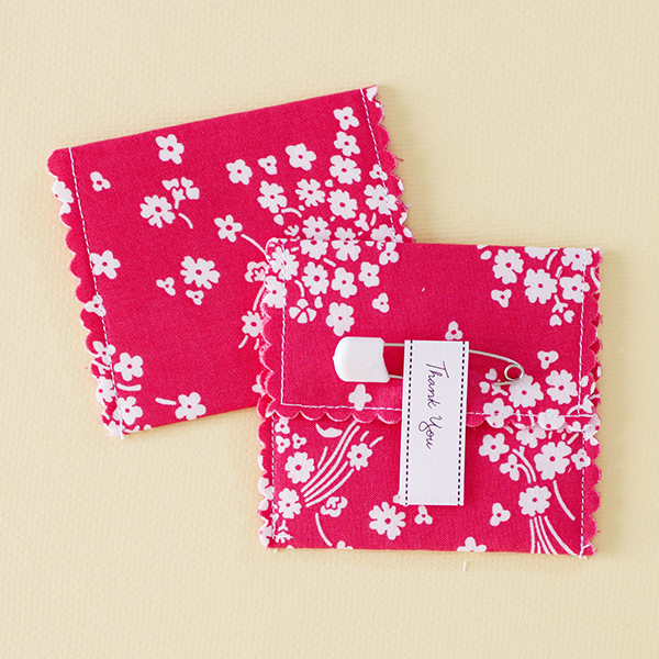 Akachan - (also means red little child in Japanese) White little flowers on a red fabric favour pouch