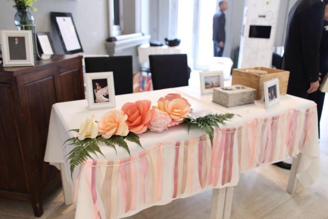 Reception table with paper flower and ribbon streamers