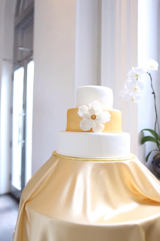 3 tier wedding cake with gold sash
