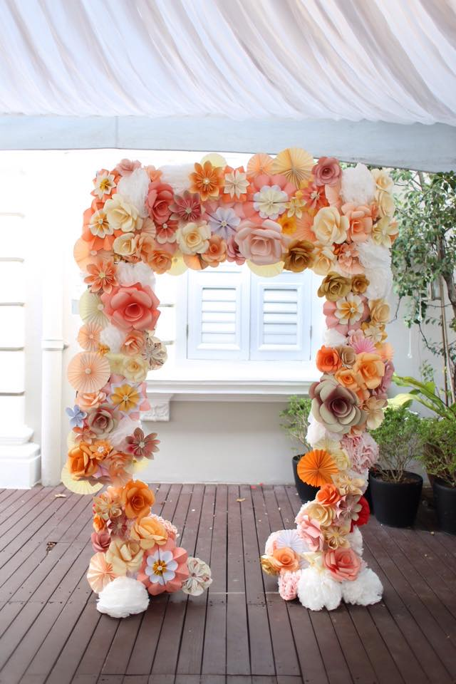 Handmade paper flower wedding arch