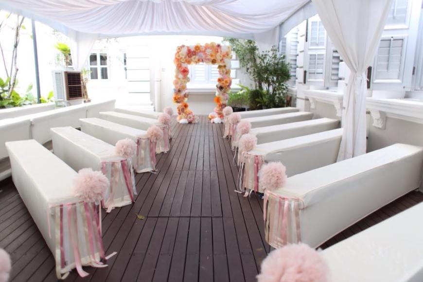 Paper flower arch, ribbon streamers, organza pom poms