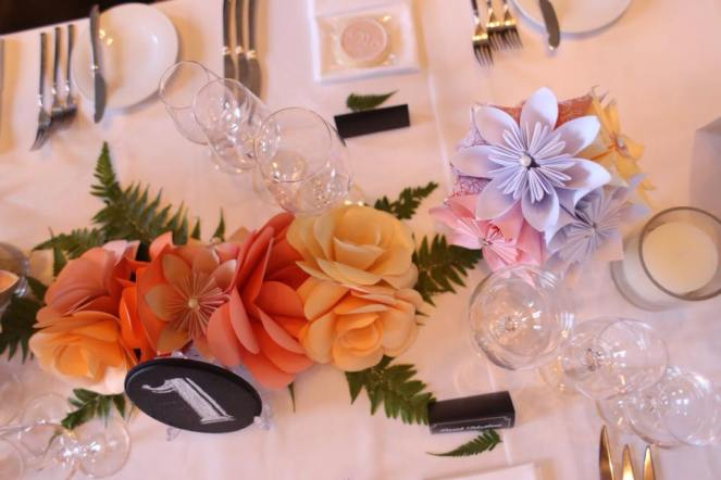 Paper flower table centerpiece with chalkboard table number