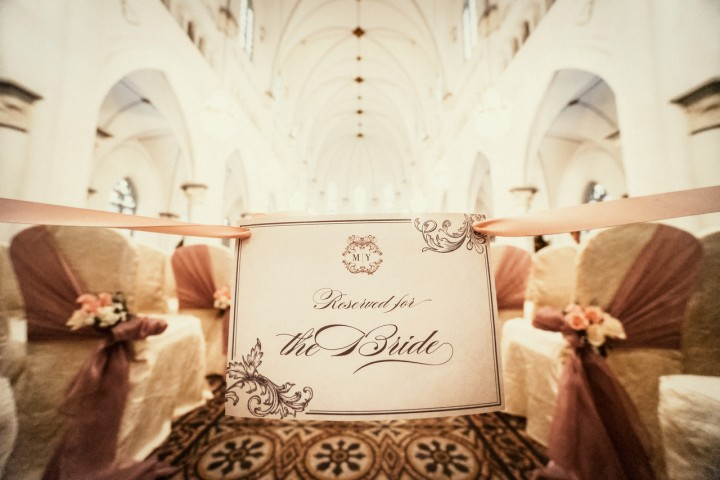 The aisle is reserved for the bride to prevent guests from kicking the candles along the aisle. Photo credit - Light&Memories