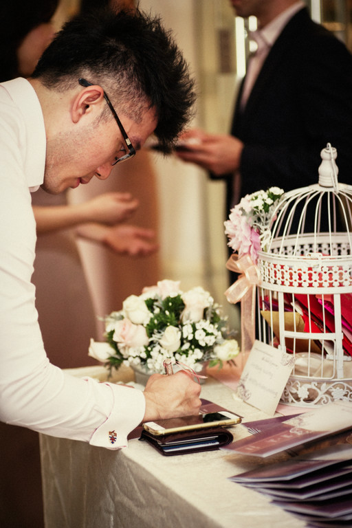 Wishing corner for guests to pen down their wishes for the couple. Birdcage ang bao box in the background - Photo credit Light&Memories