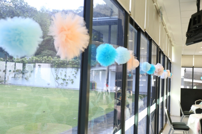 Soft organza pom poms in blues, whites and pink