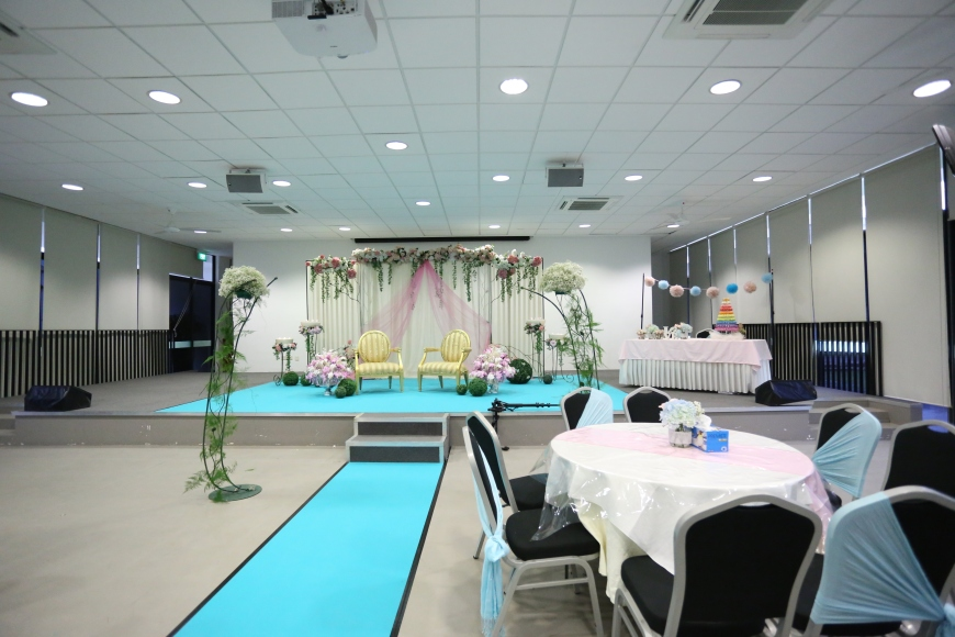 Stage decor: Dias, flower stands blue carpet and bridal table