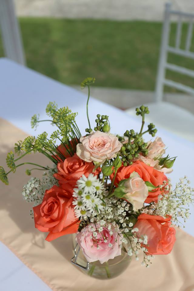 Peach coloured floral arrangement on ROM table