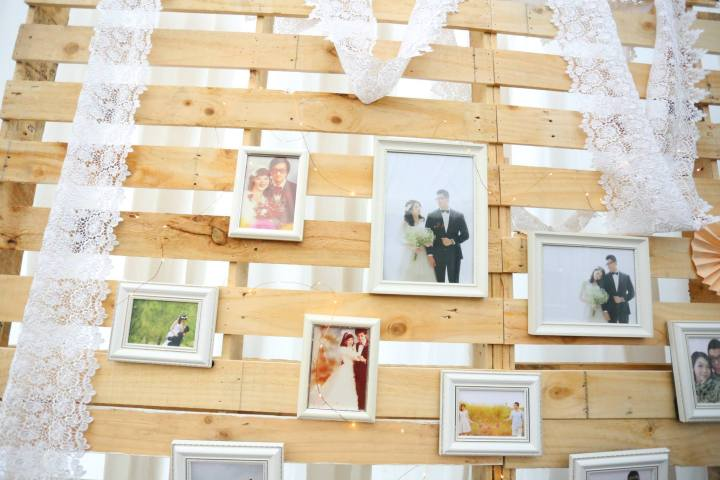 Wooden palette photo gallery backdrop with mini fairy lights
