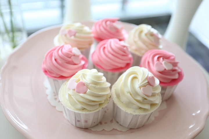 Cupcakes with white and pink frosting