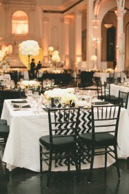 Black tiffany chairs, chevron table runner and simple table decor to tie in with the theme elegantly